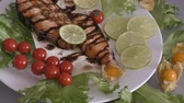 salmon pink : Grilled trout with fresh Greens and vegetables