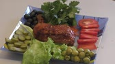 cooking : Fried chicken thigh with fresh Greens for lunch Stock Footage