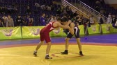 postura : Orenburg, Russia - January 28, 2016: Boys compete in freestyle wrestling on Championships of Orenburg