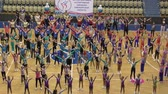 edzés : Orenburg, Russia - December 9, 2017 year: girls compete in sports aerobics in sports aerobics for the cup of the Orenburg region on fitness and sports aerobics. Stock mozgókép