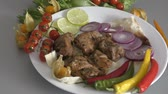 espetos : Skewers of pork meat with fresh Greens and vegetables