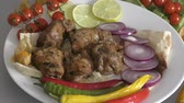 grelha : Skewers of pork meat with fresh Greens and vegetables