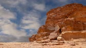 nabataean : Wadi Rum Desert Jordan Middle East also known as The Valley of the Moon is a valley cut into the sandstone and granite rock in southern Jordan 60 km to the east of Aqaba Stock Footage