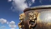 patio : Large bronze bowl to extinguish fire with image Chinese dragon statue in the Forbidden City. Beijing, China