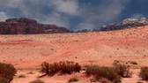 nabataean : Wadi Rum Desert, Jordan, Middle East-- also known as The Valley of the Moon is a valley cut into the sandstone and granite rock in southern Jordan 60 km to the east of Aqaba Stock Footage