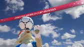 maskot : Official symbols of the 2018 FIFA World Cup in Russia (against the sky with clouds) Stok Video