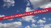fãs : Official symbols of the 2018 FIFA World Cup in Russia (against the sky with clouds) Vídeos