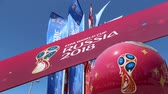 maskot : Official symbols of the 2018 FIFA World Cup in Russia (against the background of Welcome flags)
