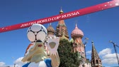 yakınlaştırma : Official symbols of the 2018 FIFA World Cup in Russia (against the background of Moscow landmarks) Stok Video