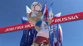 fãs : Official symbols of the 2018 FIFA World Cup in Russia (against the background of Welcome flags)