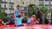 playground : children jumping on a trampoline in a childrens park