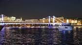 capitais : Krymsky Bridge or Crimean Bridge (at night) is a steel bridge in Moscow, Russia. The bridge spans the Moskva River 1800 meters south-west from the Kremlin Stock Footage