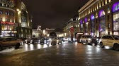 international landmark : Christmas (New Year holidays) decoration in Moscow (at night), Russia. Traffic cars in the center near the Kremlin. Lubyanskaya (Lubyanka) Square Stock Footage
