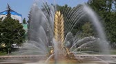 statua : Golden Spike fountain on Kamensky pond in VDNH park. VDNKh (also called All-Russian Exhibition Center) is a permanent general-purpose trade show in Moscow, Russia
