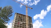 scaffolding : Multi-storey building under construction (new residential complex). Construction site upon renovation program in Cheryomushki district, Moscow, Russia