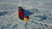 baloon : Hot air balloon flying above ice Stock Footage