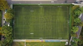 tým : Aerial view of the football field. Unrecognizable people practice to play football