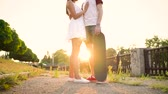 casado : Young couple in love kissing on the street at sunset Vídeos
