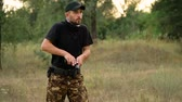 калибр : Young man in camouflage shooting from a gun, close up