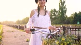 ciclista : Young beautiful woman riding a bicycle at sunset