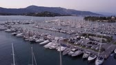 privado : Flight over a dock with a lot of yachts and boats - shooting from a drone