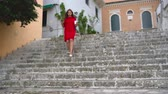 correspondência : Busy woman uses a smartphone while running down the stairs outdoors
