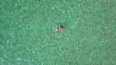sentir : View from the height on swimming woman in the clear sea
