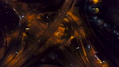 freeway interchange : Vertical top down aerial view of traffic on freeway interchange at night Stock Footage
