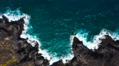 kanári szigetek : Top view of a deserted coast. Rocky shore of the island of Tenerife. Aerial drone footage of sea waves reaching shore