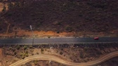 racing : Top view of a car rides along a desert road on Tenerife, Canary Islands, Spain. Timelapse