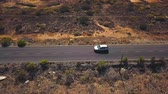 kanárské ostrovy : Top view of a car rides along a desert road on Tenerife, Canary Islands, Spain