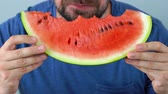 wedge : Bearded man eats a juicy watermelon Stock Footage
