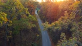 logistika : Aerial view on autumn forest road. Scenic autumn landscape