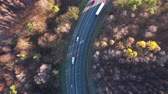 logistika : View from the height of the traffic on the road surrounded by autumn forest