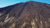 溶岩 : Aerial view of the Teide volcano in Teide National Park, flight over the mountains and hardened lava. Tenerife, Canary Islands