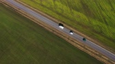 agricultura : Top view of a cars driving along a rural road between two fields