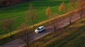 agricultura : 4 in 1 video. Top view of a cars driving along a rural road between two fields Stock Footage