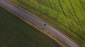 agricultura : Top view of a car driving along a rural road between two fields