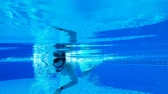 turkus : Underwater shooting as a man swims under the water