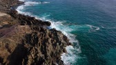 turkus : Top view of a deserted coast. Rocky shore of the island of Tenerife. Aerial drone footage of sea waves reaching shore
