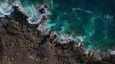 ondulation : Top view of a deserted coast. Rocky shore of the island of Tenerife. Aerial drone footage of sea waves reaching shore