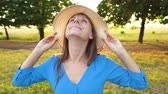 piscar : Portrait of pretty woman with hat outdoors in sunny day closeup