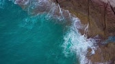kamień : Top view of the desert stony coast on the Atlantic Ocean. Coast of the island of Tenerife. Aerial drone footage of sea waves reaching shore