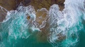 pedregoso : Top view of the desert stony coast on the Atlantic Ocean. Coast of the island of Tenerife. Aerial drone footage of sea waves reaching shore