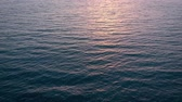 silouhette : Aerial view of surface of the Atlantic Ocean on the background of a beautiful sunset. Shooted at different speeds: normal and fast Vidéos Libres De Droits