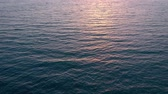 silouhette : Aerial view of surface of the Atlantic Ocean with reflection of sunlight at sunset Vidéos Libres De Droits