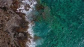 dalgalı : Top view of a deserted coast. Rocky shore of the island of Tenerife. Aerial drone footage of ocean waves reaching shore
