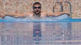 yüzücü : Swimmer doing the butterfly stroke in the swimming pool in slow motion