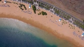 coastal road : Top view of Las Teresitas beach, road, cars in the parking lot, golden sand beach and the Atlantic Ocean. Tenerife, Canary Islands, Spain Stock Footage