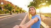 schenken : Follow me - woman gives hand to man behind the scenes. Slow motion Videos